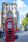 Double decker bus and red telephone booth on London street Stock Photos