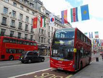 Double decker bus in Regent street. On July 19, 2012, London, UK. Street is decorated with international flags to celebrate the Olympic games 2012 Stock Images