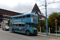 Double Decker bus on the street of Ushuaia. Royalty Free Stock Images