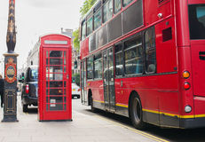 Double decker bus and telephone booth in london Stock Photos