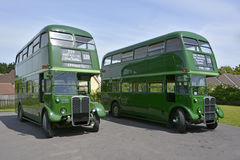 Double decker buses in Green Line livery. Two old London double decker buses in Green Line livery on route 339 in Essex Royalty Free Stock Images