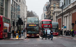 Double decker buses in traffic on the London`s street. Stock Photo