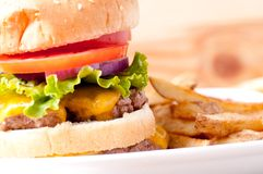Double decker cheeseburger. With fresh french fries Royalty Free Stock Photography