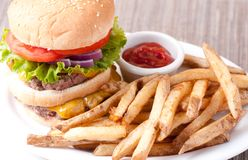 Double decker cheeseburger. With fresh french fries Stock Image