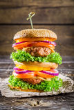 Double-decker homemade burger made ��from fresh vegetables Royalty Free Stock Photo
