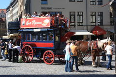 Double Decker horse carriage ride Dresden. People enjoying a summer day at double  Decker horse carriage ride in Dresden, Germany, Europe Royalty Free Stock Images