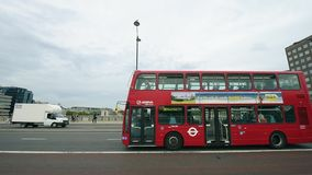 Double decker London Bridge in London with people buses. LONDON, UNITED KINGDOM - CIRCA 2016: Double Decker traditional British bus on the London Bridge with stock video footage