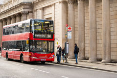 Double Decker London Bus at Bus Stop Stock Photography