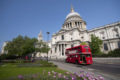 Double decker passing by front of St Paul. 's Cathedral. Summer sky for copy space Royalty Free Stock Photo