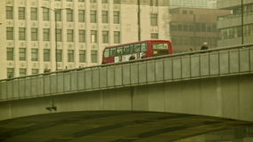 Double decker passing on the London Bridge from the right