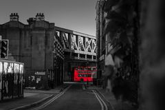 London double decker bus under bridge stock images