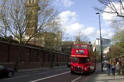 Double decker red bus London Street. A Double decker bus running through the old street of London, UK Royalty Free Stock Photography