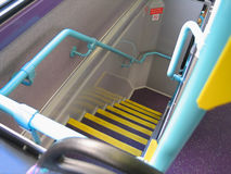 Double decker stairway. Descent down angular stairway in double decker bus Stock Photo
