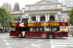 Double-decker tour bus in front of the New York City Library Royalty Free Stock Photo
