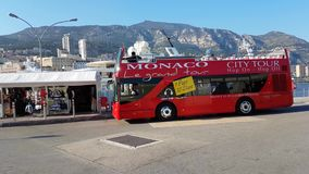 Double-Decker Tourist Bus On The Port Of Monaco. Monte-Carlo, Monaco - March 28 2017: Red Double-Decker Tourist Bus On The Port Of Monaco With Skyscrapers stock footage