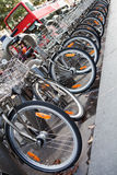 Double-decker tourist city bus and bicycle fleet Royalty Free Stock Images