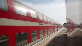 Double-decker train arrives at the platform in Israel. Double-decker red train arrives at the platform in Israel stock video