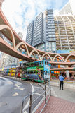 Double-decker tram Hong Kong. Hong Kong, China - December 6, 2016: a colorful double-decker trams passes under elevated walkway between Pennington Street and Yee Royalty Free Stock Images