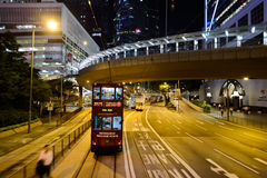 Double-decker tram on street of HK Stock Photos