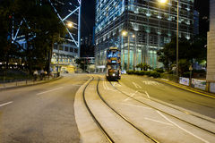 Double-decker tram on street of HK Stock Photography