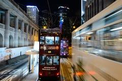 Double-decker tram on street of HK Stock Images