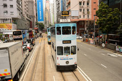 Double-decker tram on street of HK Stock Images