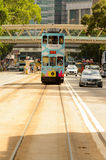 Double-decker tram on street of HK Stock Photo