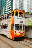 Double-decker tram on street of HK Royalty Free Stock Image