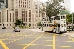 Double-decker tram on street of HK Stock Photography