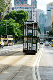 Double-decker tram on street of HK Royalty Free Stock Images