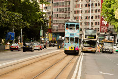 Double-decker tram on street of HK Stock Photos