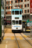 Double-decker tram on street of HK Stock Image