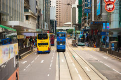 Double-decker tram on street of Hong Kong. HONG KONG - OCTOBER 25, 2015: Hong Kong double-decker tram in Central. Trams in Hong Kong is the cheapest mode of Stock Image
