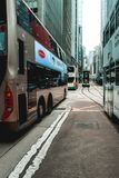 Double-decker trams and buses crossing the streets of Hong Kong stock image