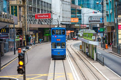 Double-decker trams. HONG KONG - OCT 25: Double-decker trams. Trams also a major tourist attraction and one of the most environmentally friendly ways of Stock Photo