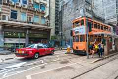 Double-decker trams ways of travelling in Hong Kong. HONG KONG - OCT 25: Double-decker trams. Trams also a major tourist attraction and one of the most Stock Photography