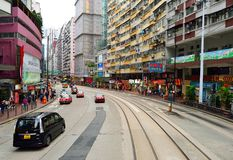 Double-decker tramway. HONG KONG - DECEMBER 25, 2015: view from upper deck of double-decker tramway. The tram is the cheapest mode of public transport on Hong Stock Images