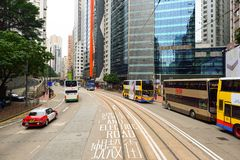 Double-decker tramway. HONG KONG - DECEMBER 25, 2015: view from upper deck of double-decker tramway. The tram is the cheapest mode of public transport on Hong Stock Photos
