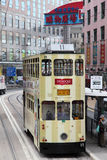 Double decker tramway, Hong Kong. Double decker tramway downtown in Central Hong Kong, China Stock Images