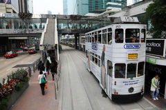 Double decker tramway, Hong Kong. Double decker tramway downtown in Central Hong Kong, China Royalty Free Stock Photography