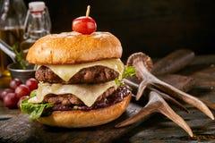 Double decker venison burger with deer antlers stock photos