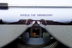 Double Dip Recession Typed on an Old Typewriter. The words Double Dip Recession typed on an old typewriter. A conceptual look at current headlines royalty free stock photo