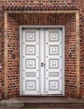 Double Door. Grey double door in red brick portal stock photos
