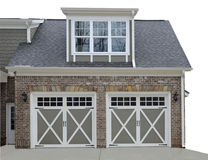 Double Door Garage on Modern House. Double door garage at the entry of a new modern home royalty free stock photography