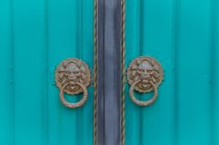 Double door in Kyrgyzstan. Double turquoise door in Kyrgyzstan royalty free stock photos