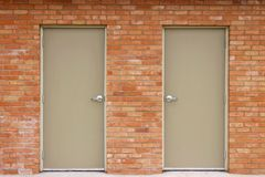 Double Doors and Brick Wall Stock Images