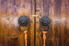 Double doors with Chinese metal door knockers Stock Image