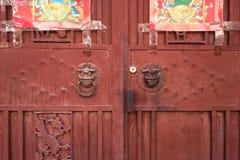 Double doors with Chinese metal door knockers Stock Photos