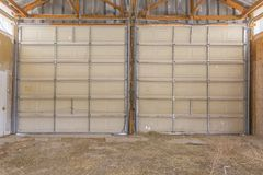 Double doors on large old barn in Utah close stock image