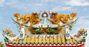 Double dragon on chinese temple roof. The Chinese Dragons on Roof in Thailand Stock Image